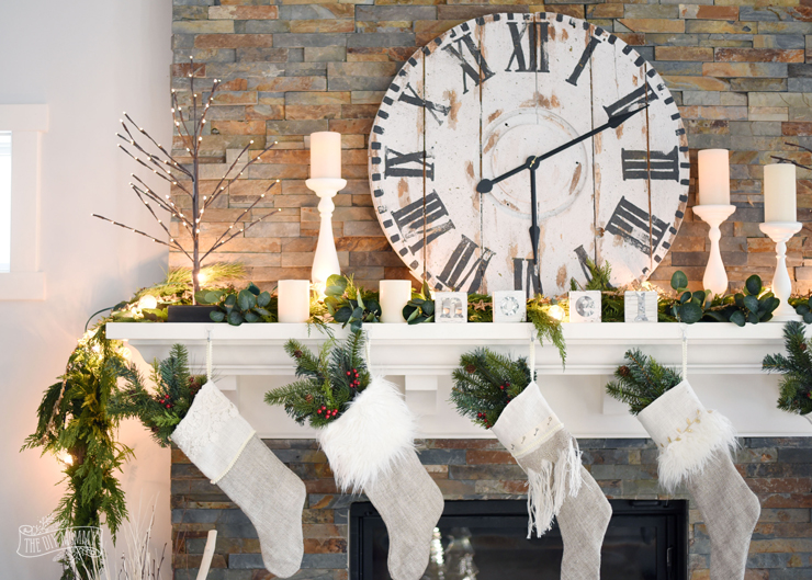 Rustic Christmas mantel with DIY wooden spool clock