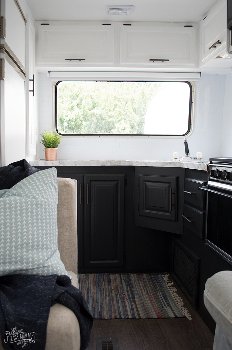 Our Diy Camper Kitchen Makeover Painting Oak Cabinets