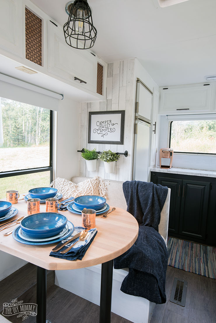 Our DIY Camper - Gorgeous, renovated RV tour with DIY paint job, vinyl plank flooring, reupholstered cushions, new hardware, updated lighting