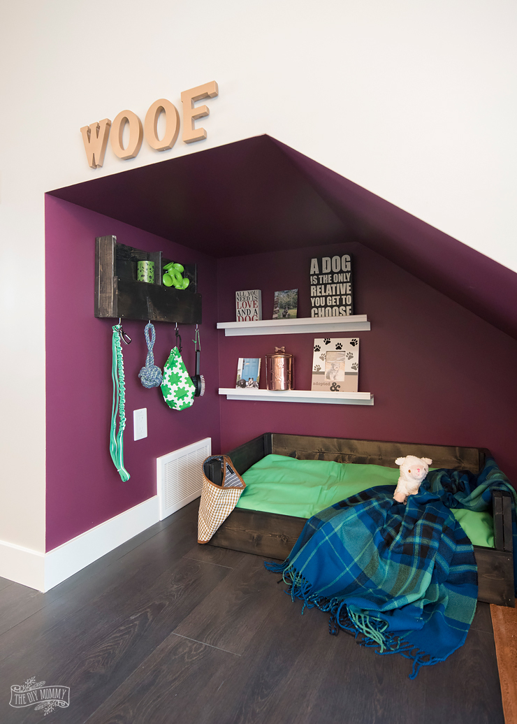 DIY dog nook under the stairs with handmade dog bed and organizer