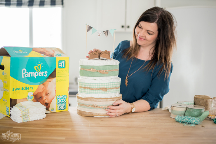 Learn how to make a diaper cake - this one is so cute and rustic with NO diaper rolling!