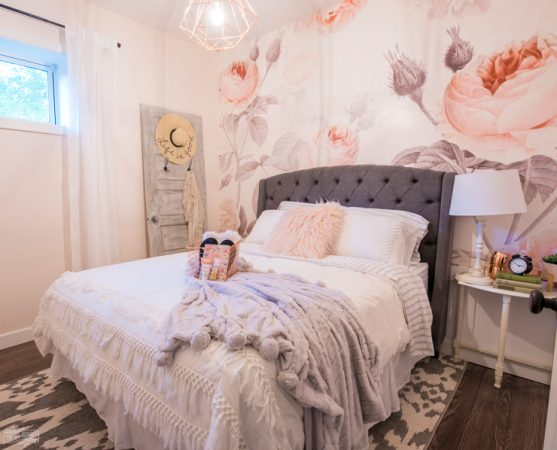 Feminine Modern Farmhouse Guest Bedroom Makeover with large floral wall mural, upholstered headboard, and blush pink, grey and copper colors