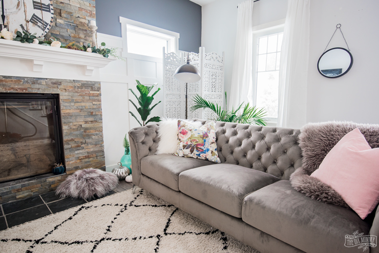 How to style a grey tufted velvet couch