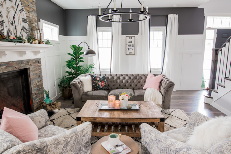 A cozy, rustic glam traditional living room in black, white, grey & pink