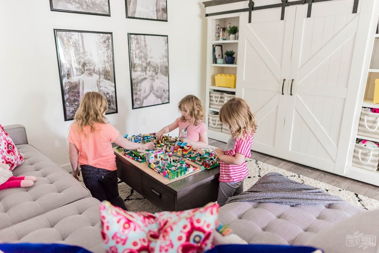 Beautiful and practical basement TV play room in a modern farmhouse style with tons of storage and DIY ideas