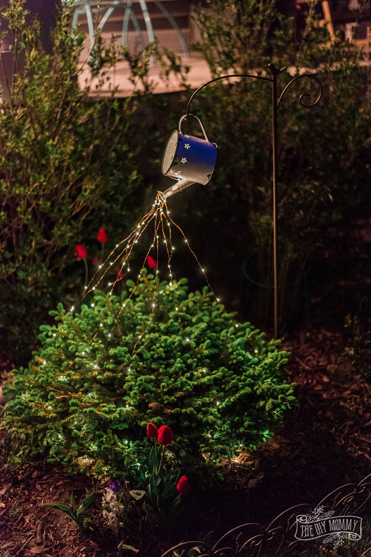 DIY faux enamelware watering can light feature for garden
