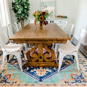 Dining room with colorful persian rug in green, pink, yellow, orange and blue
