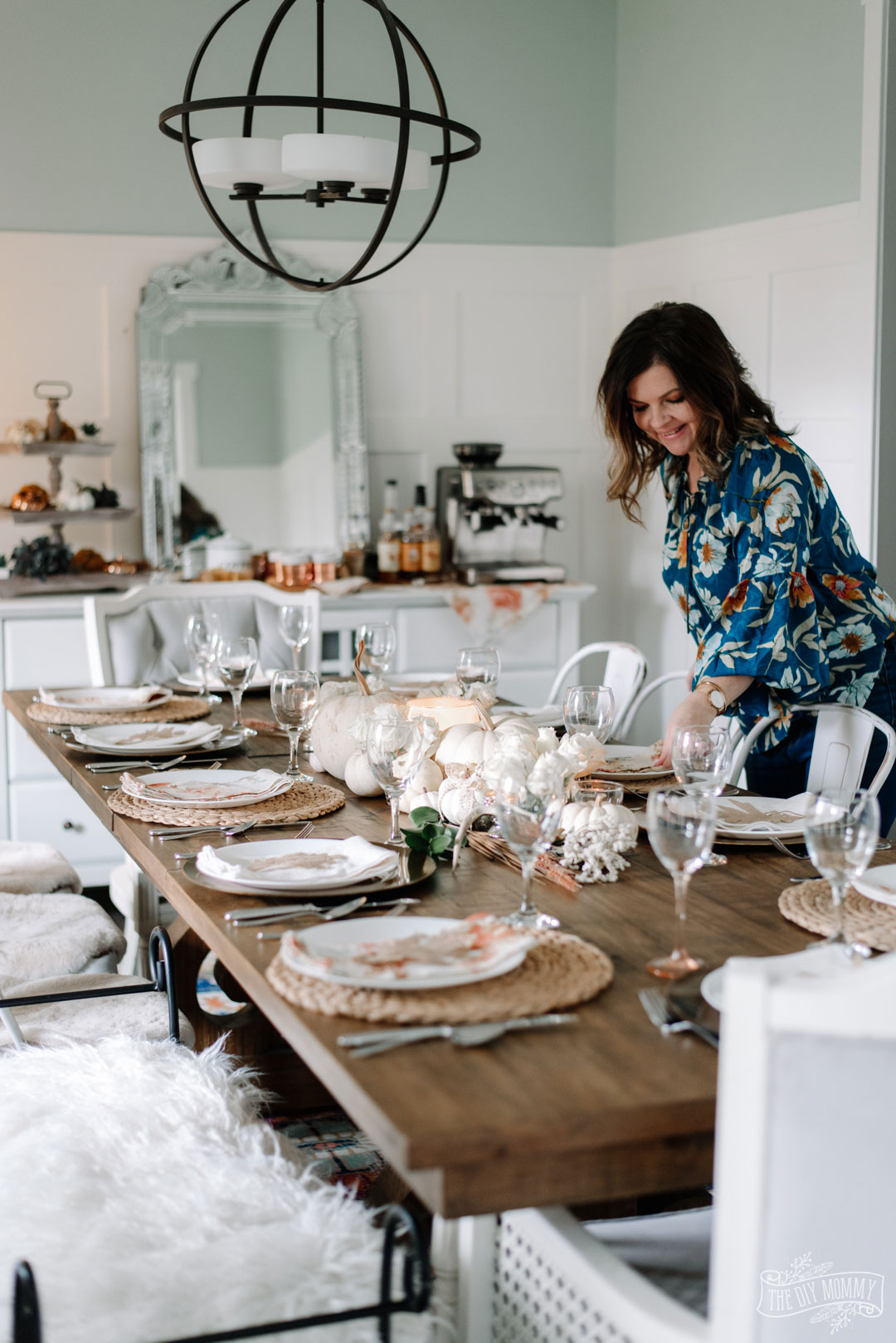 Elegant, romantic Thanksgiving tablescape idea for 12 in whites, creams and a mix and match style