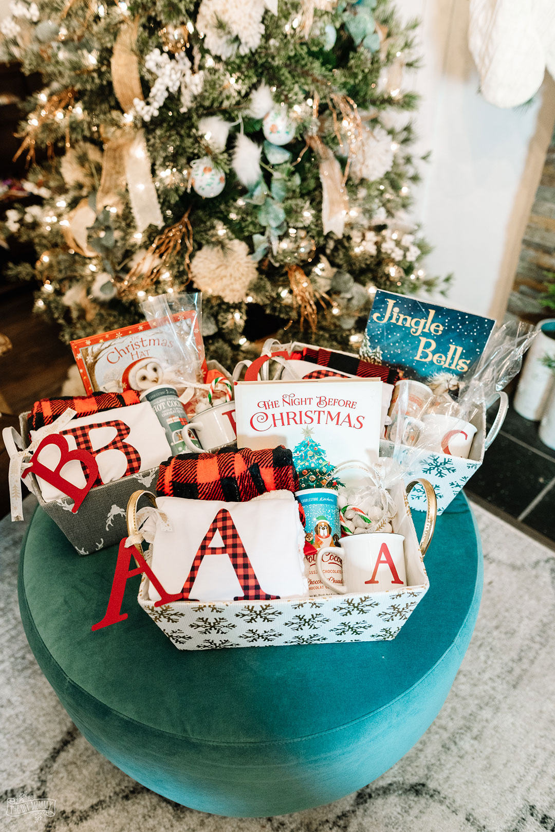 Learn how to make a personalized Christmas Eve box, what goes in a Christmas Eve box, and why you should do it