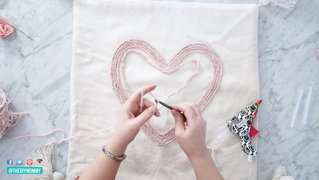 DIY Heart Pillow for Valentine's Day with a crochet chain, glue & pre-made pillow cover