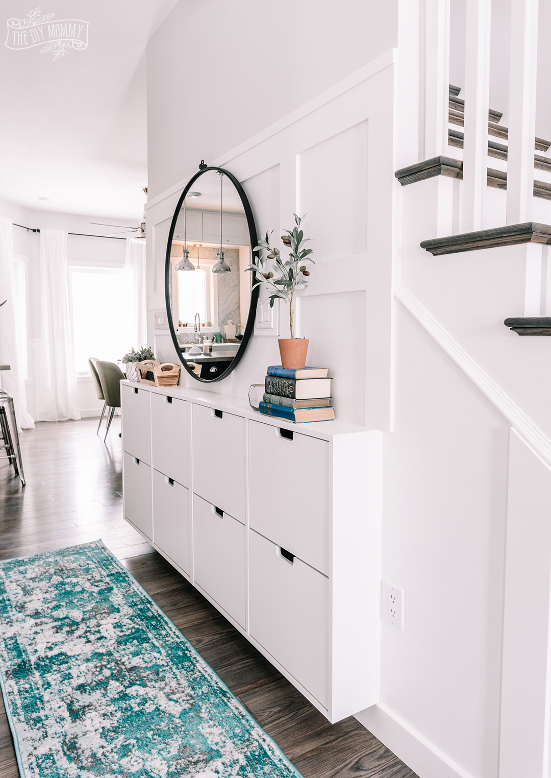 Small Entryway Makeover in a narrow hallway using Ikea Stall shoe storage and DIY board & batten
