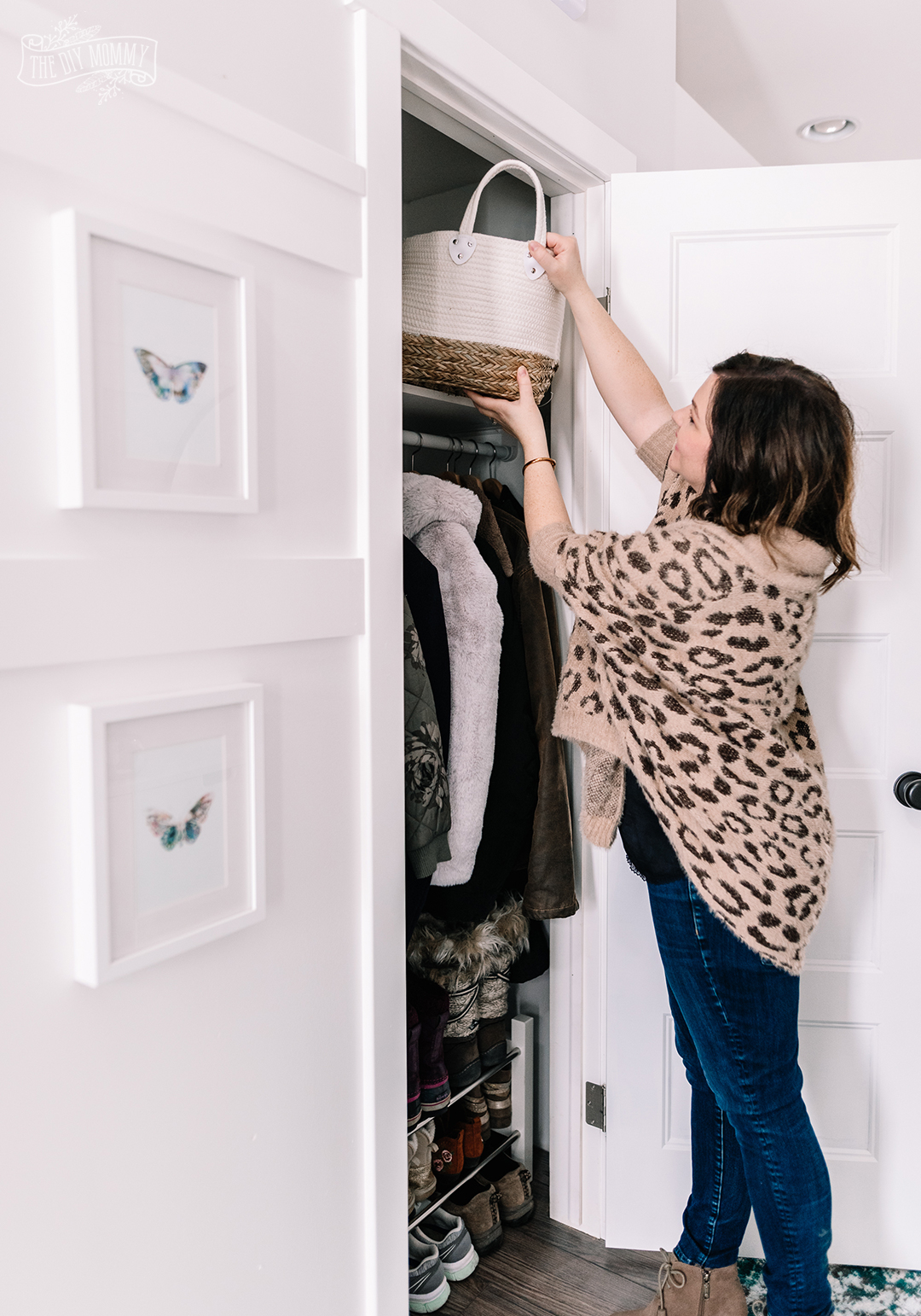 Small Entryway Makeover organized closet with baskets and shoe rack