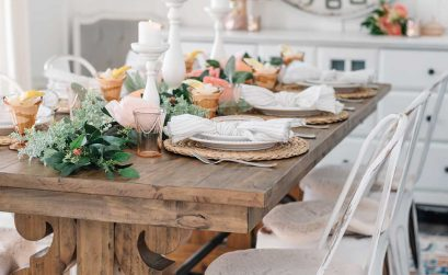 Spring / Easter tablescape idea in warm pinks, oranges, and vintage-inspired accessories.