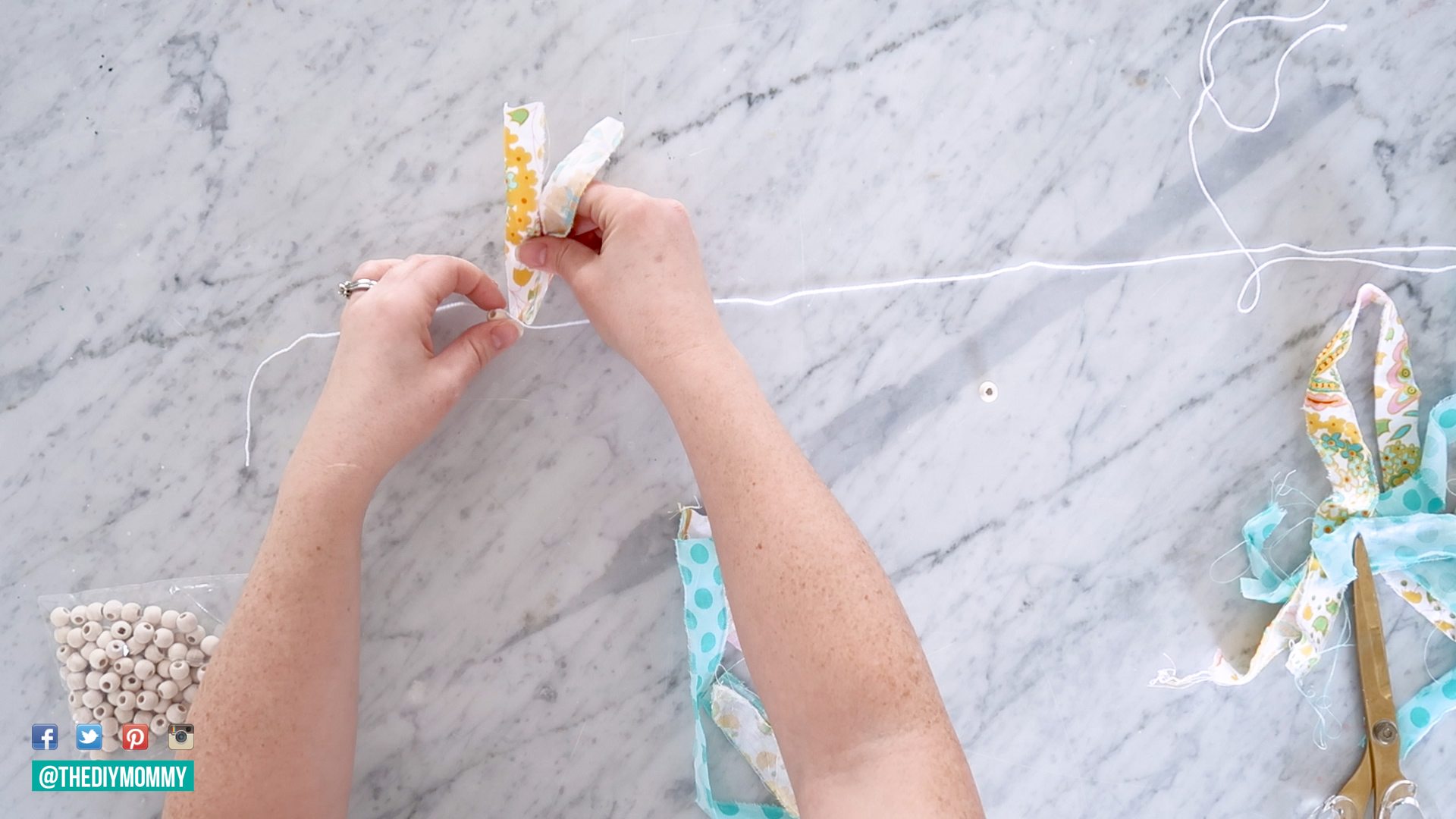 Learn how to make a DIY scrap fabric garland to decorate an Easter basket or use as wall decor
