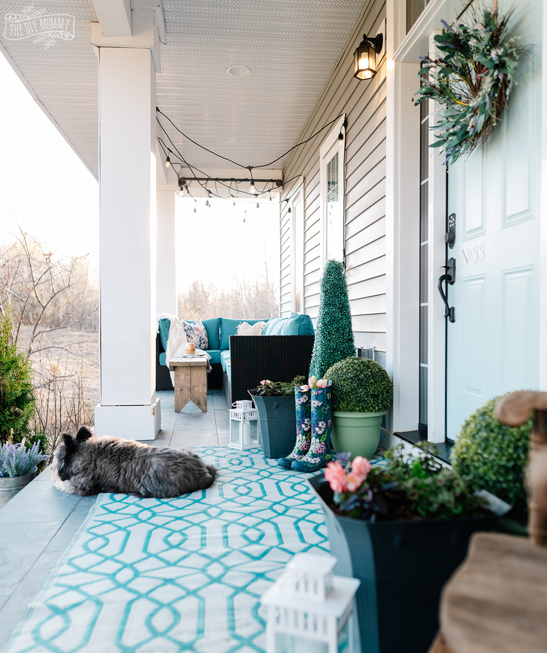 Simple ways to refresh your porch like painting a front door, using what you have on hand, cleaning and planting easy planters