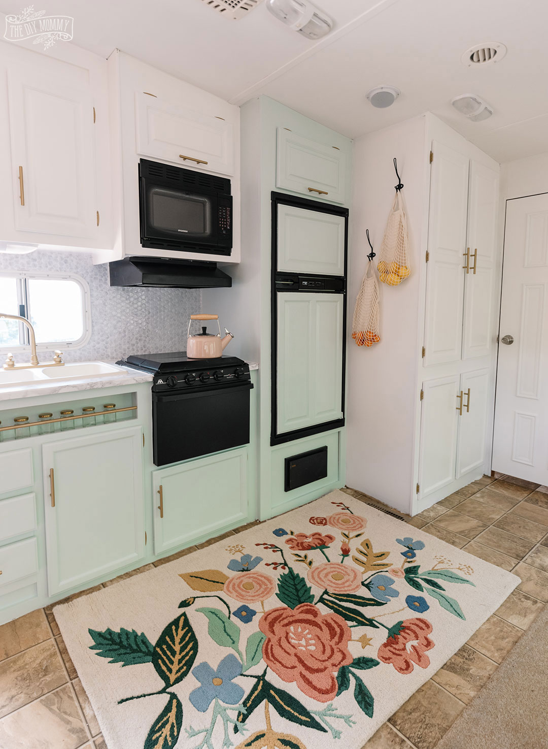 Glam RV Kitchen Makeover with white paint, mint green paint, and metallic gold accents