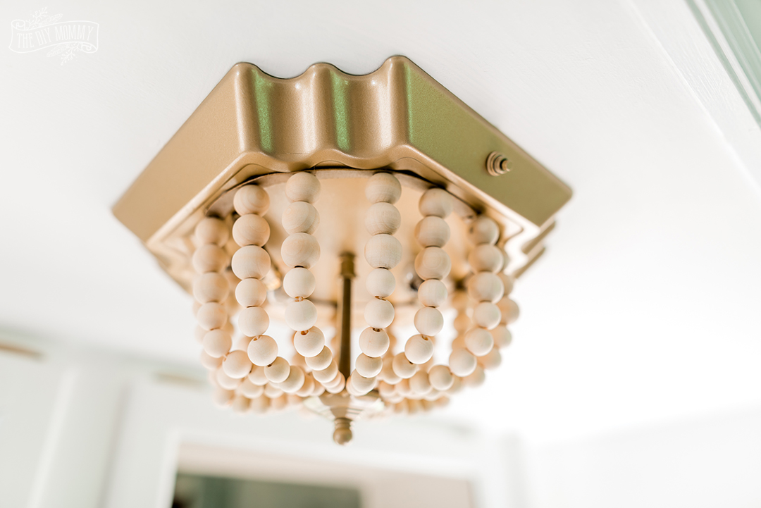 See how I transformed a flush mount fixture in our camper with this ceiling light DIY $7 boho makeover!
