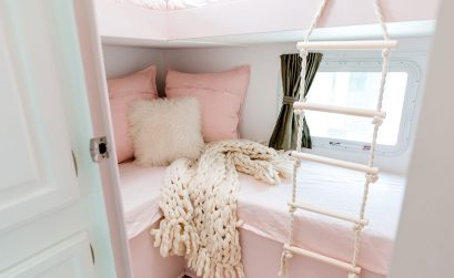 A dated RV bunk room is transformed into a pink & floral oasis for three girls.