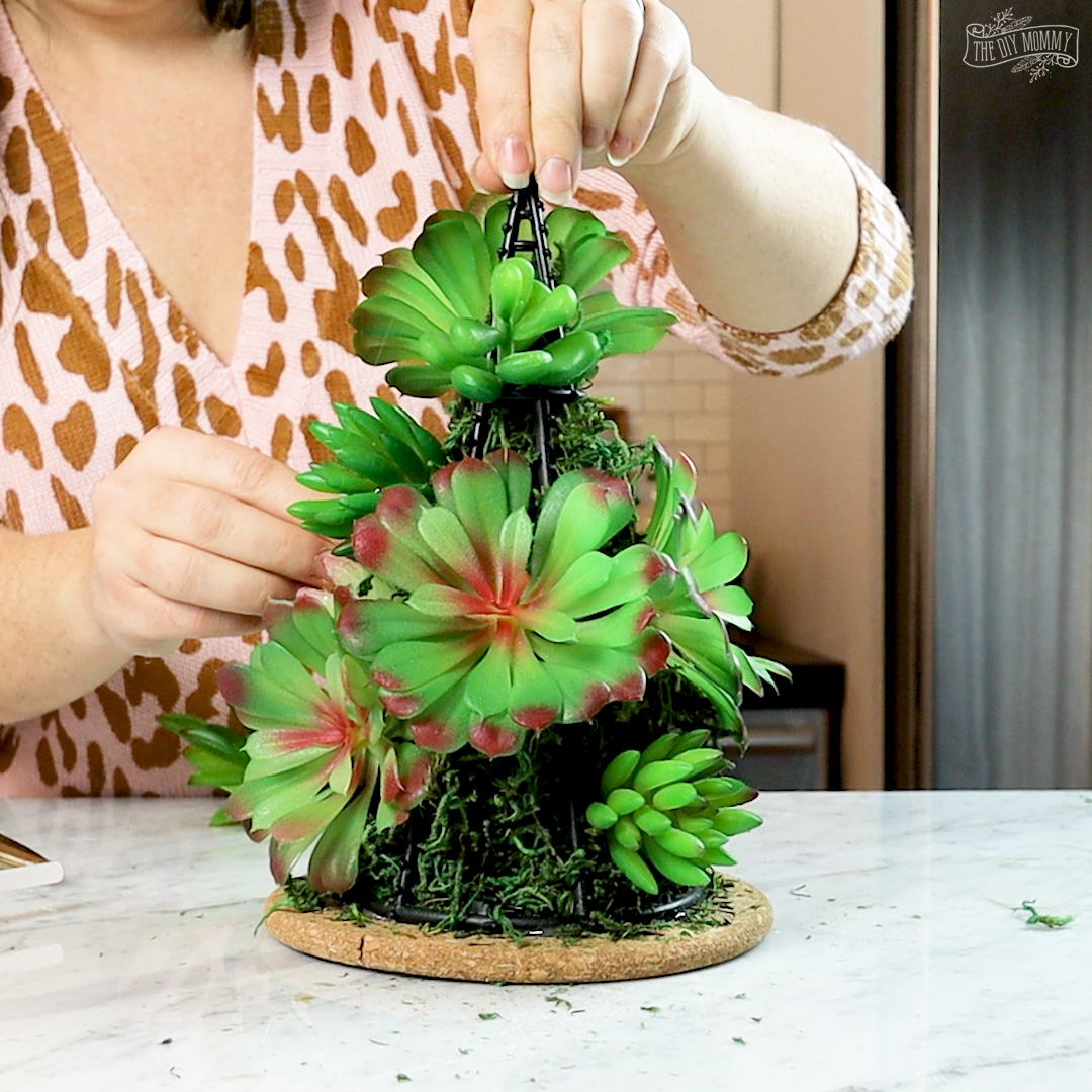 Make a faux succulent Christmas tree tabletop decor with all Dollar Tree supplies!