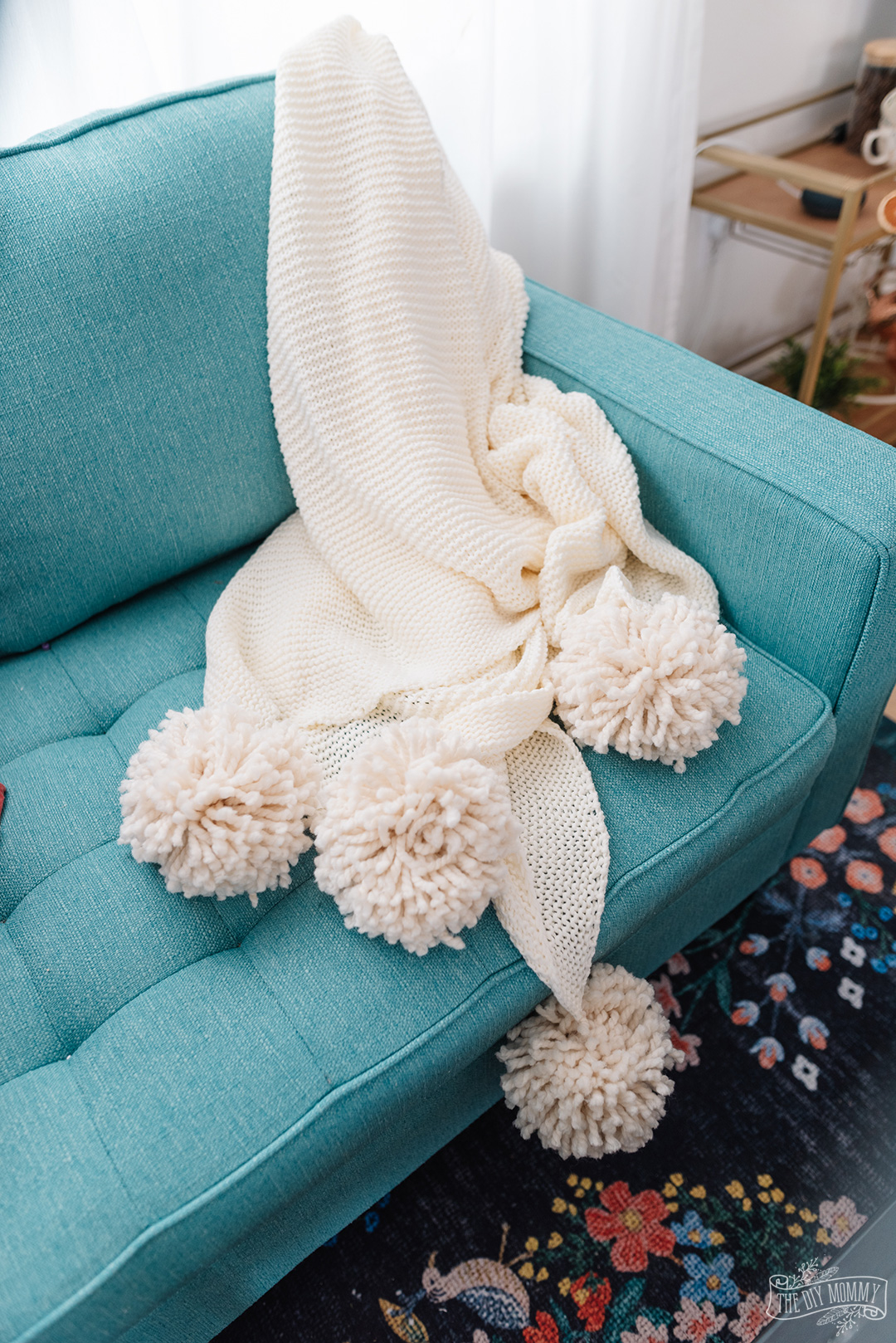 IKEA hack: pom-pom throw blanket!