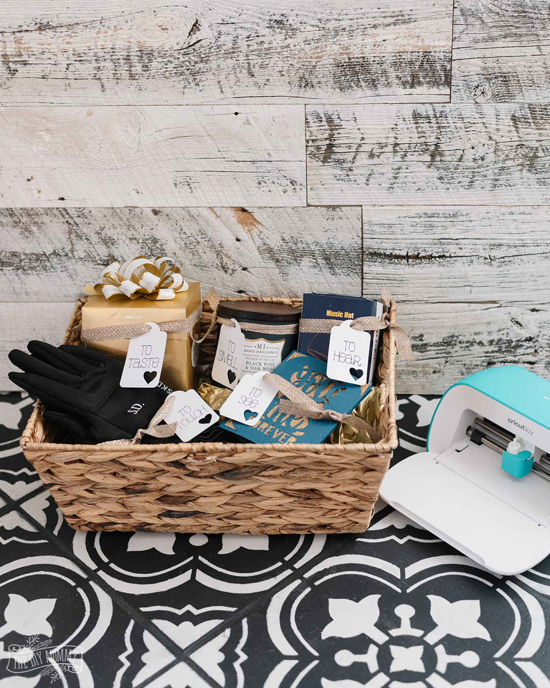 Make a heartfelt gift basket for a significant other featuring items that they can see, smell, taste, touch and hear. Here's an idea of what to include, and how to make gift tags & personalization with Cricut Joy.