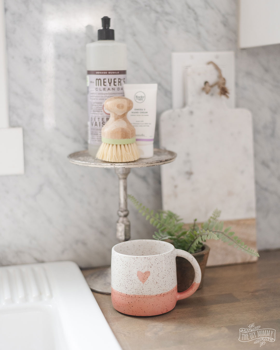 "Learn how to create a simple DIY ""LOVE"" tea towel and get easy, neutral Valentine's Day decorating ideas for the kitchen"