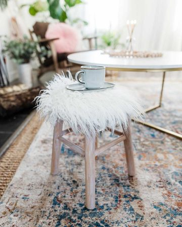 Turn a plain wooden counter stool into a cozy, Scandi inspired faux fur accent stool.