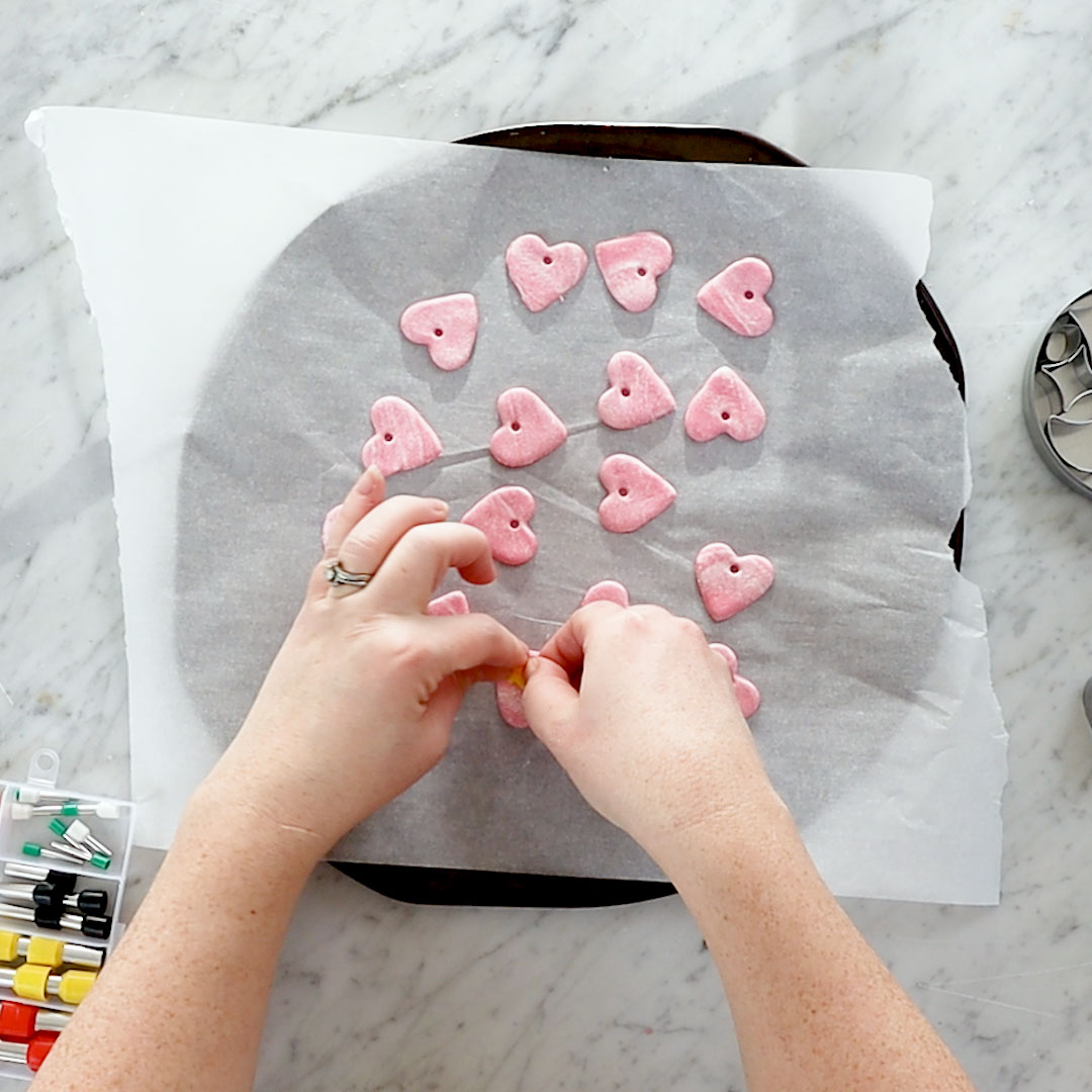 Learn how to make these simple DIY polymer clay marbled heart ornaments for Valentine's Day decor.