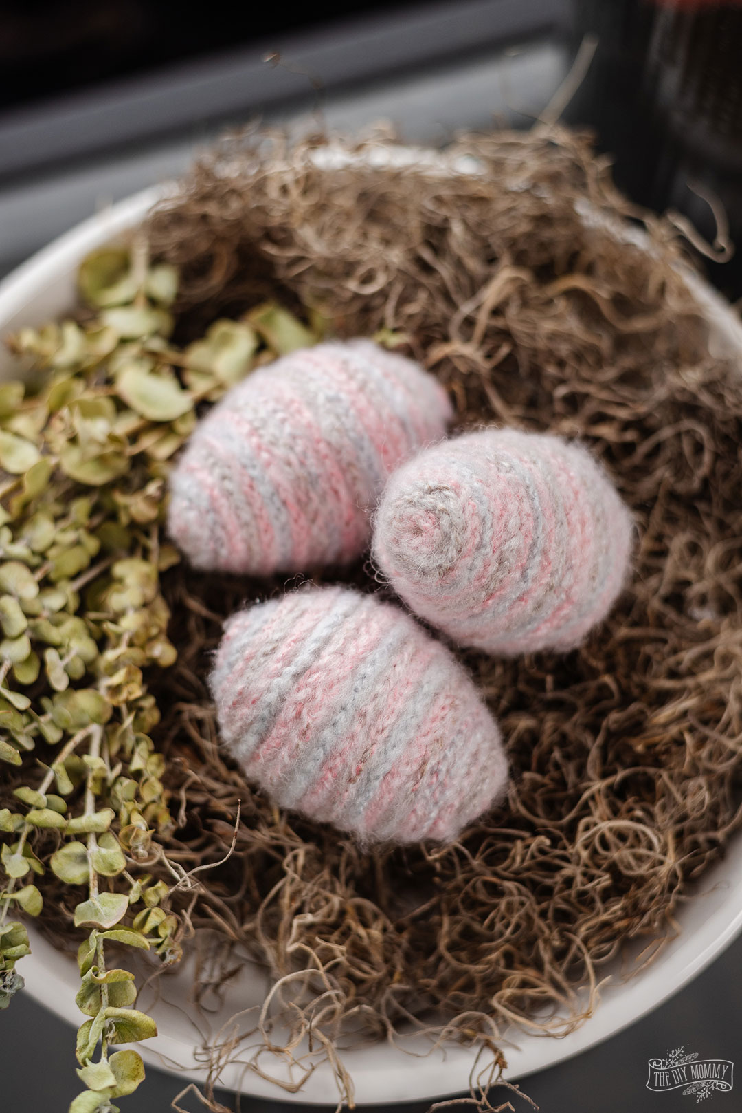 Learn how to make adorable, fuzzy Easter eggs from Dollar Store plastic eggs and crochet chains.