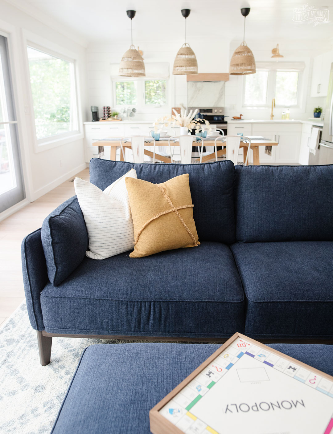 See how a boring, dated living room was transformed into a coastal modern farmhouse space with a DIY shiplap fireplace and adorable office nook with storage.