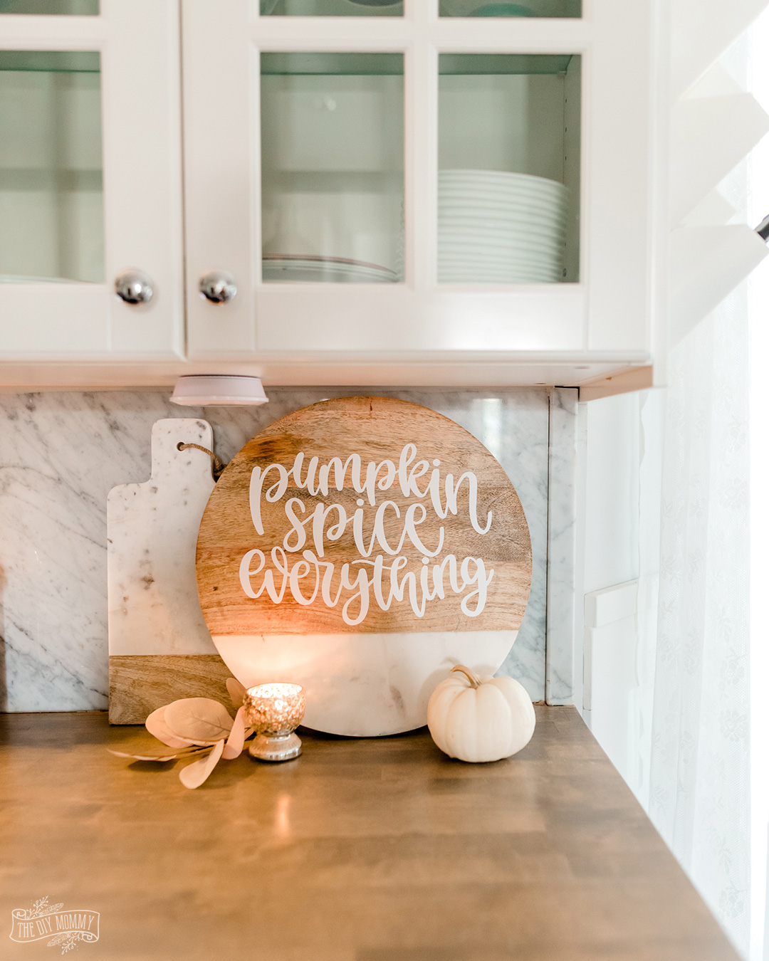 Learn how to make a simple DIY Fall cutting board for autumn decor with a Cricut