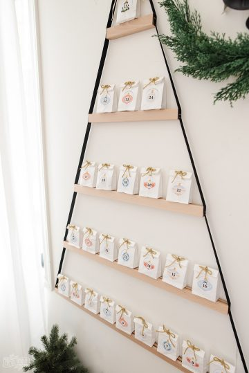 This holiday season, create an easy DIY advent calendar for kids! See how to make a unique day-by-day IKEA hack calendar with crystals inside.