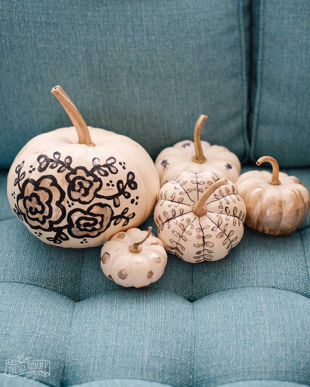 Black and gold painted pumpkins